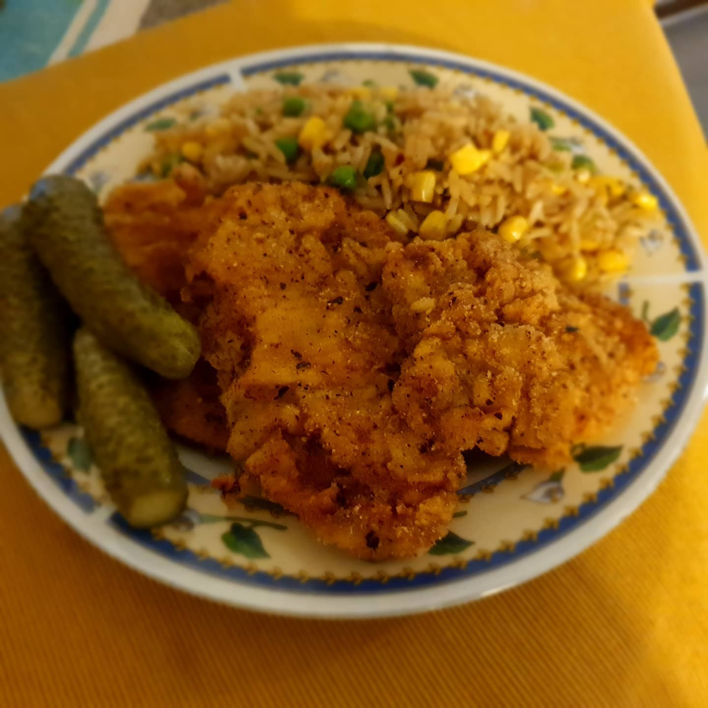 Prok breadcrumb snitzel night with a butter, corn and peas